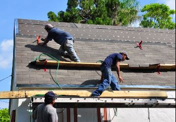 Workers working on roof