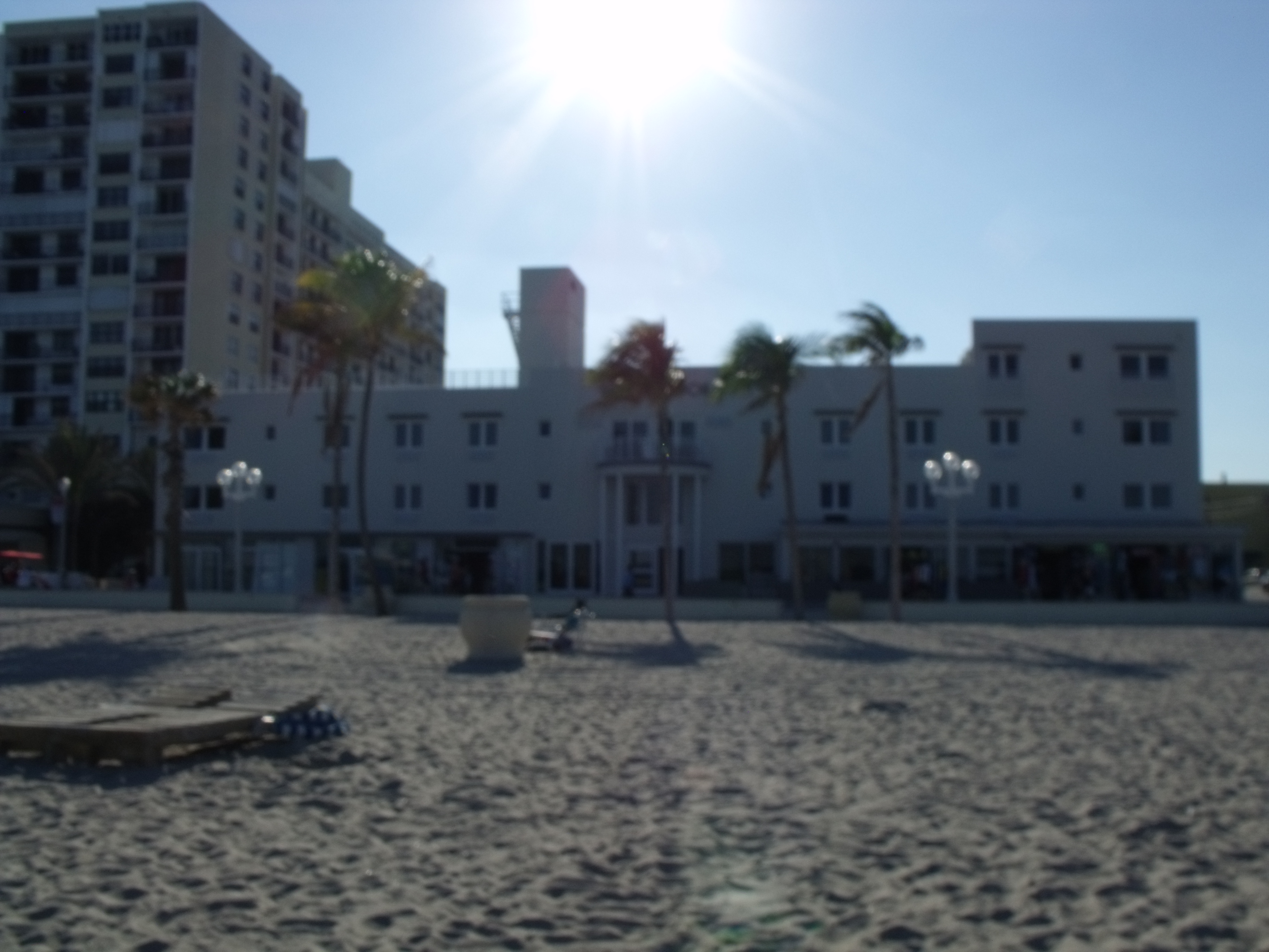 White Building on Beach with Palm Trees
