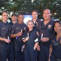 Firefighters Holding LED Candles